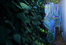 blue fist clenched in garden