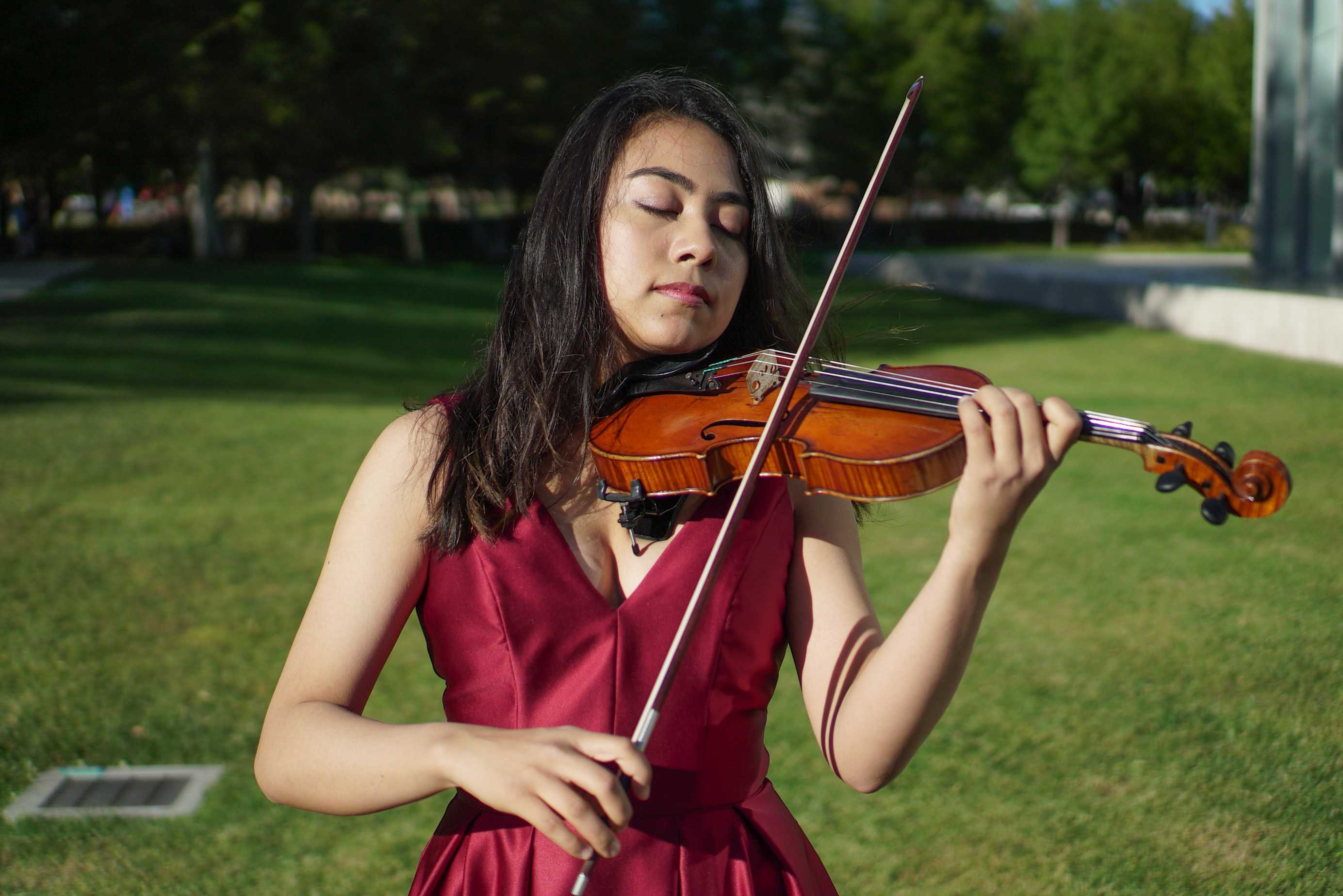 Alisa Luera, 19-years-old, is the youngest student to hold the title of first violinist in the Honors String Quartet. Photo credit: Leo Moneymaker