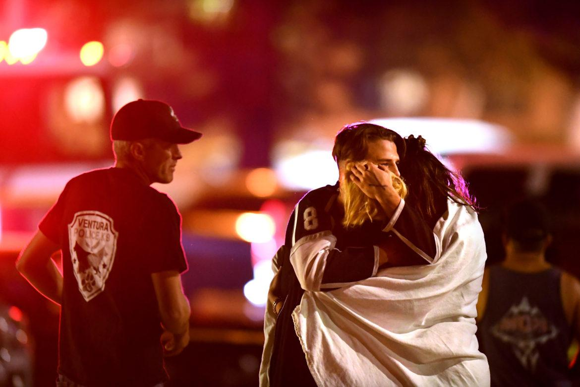 People comfort each other after a mass shooting at the Borderline Bar & Grill in Thousand Oaks late Wednesday night, Nov. 7, 2018. (Wally Skalij/Los Angeles Times/TNS)