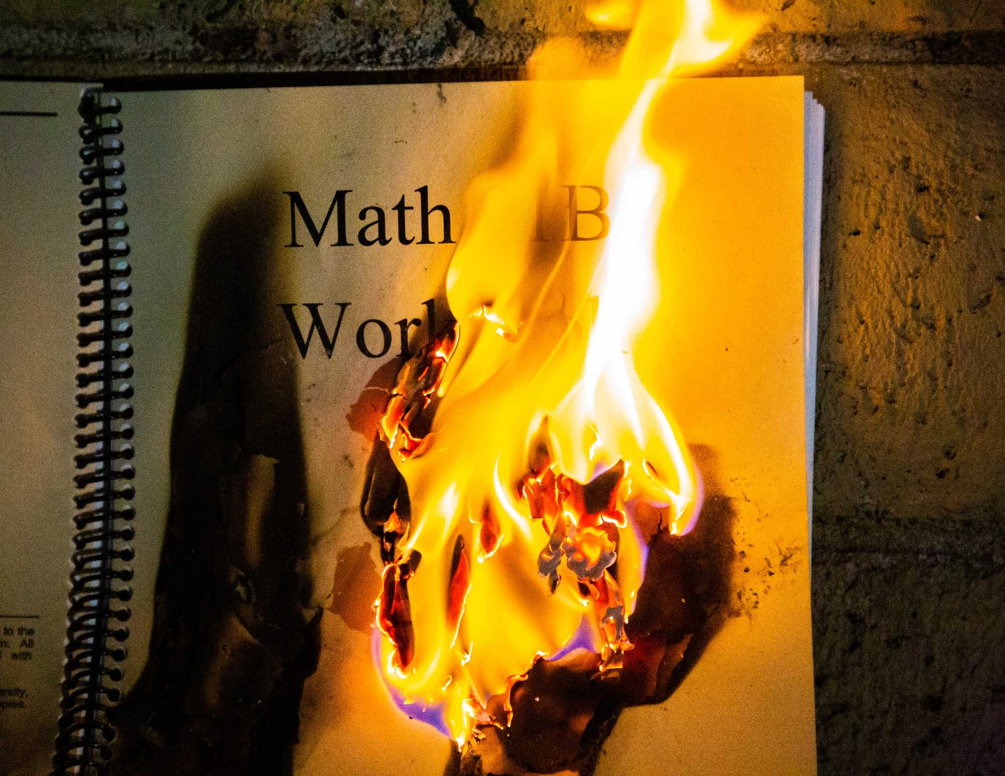 A math manual book is on fire.