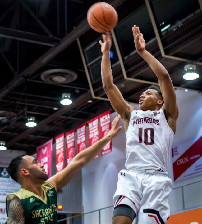 A CSUN Men's basketball player making a jump shot