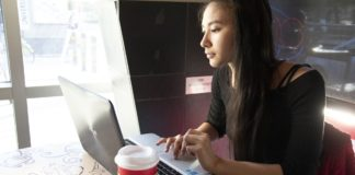 A female student using a laptop