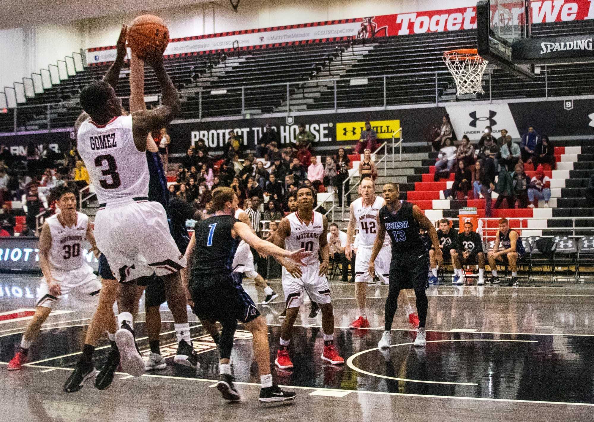A CSUN Men's basketball player making a fade away jump shot.