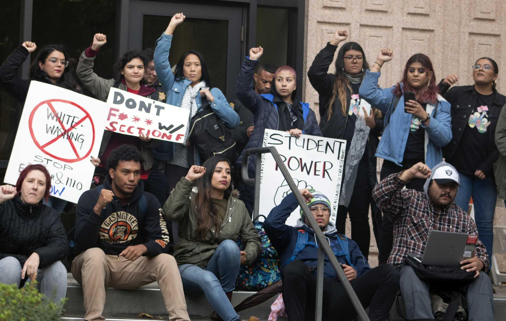 CSUN protestors sit on the steps in front of the Oviatt library where the senate meeting debating ethnic studies is being held. They raise their fists in unison to show empowerment. Photo credit: Monica Villacorta