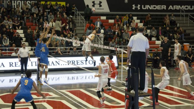 A CSUN Men's volleyball player trying to get a kill.