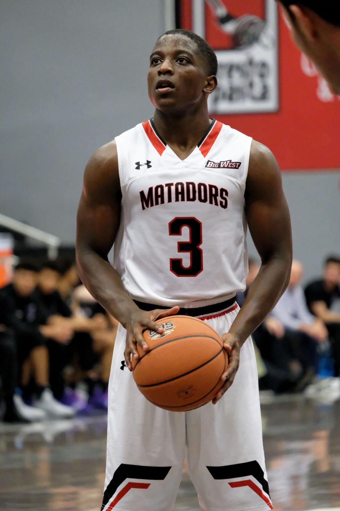 A+CSUn+Men%27s+basketball+player+in+the+white+jersey+making+free+throw