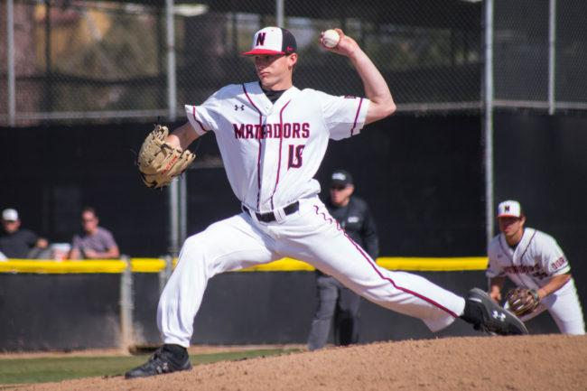 A CSUN Men's baseball pitcher in a white jersey throwing a pitch