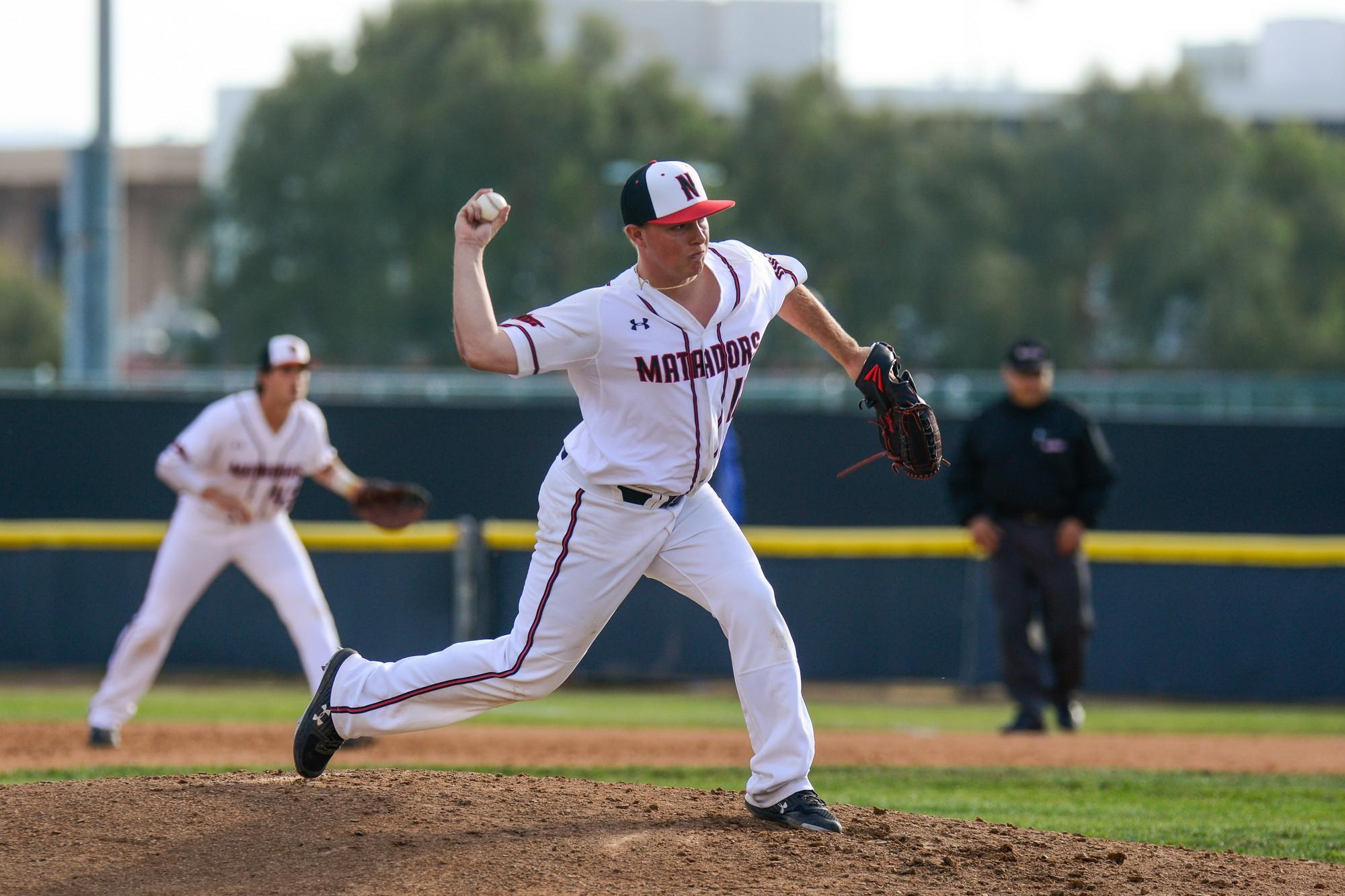 A CSUN men's Baseball pitcher throwing a pitch