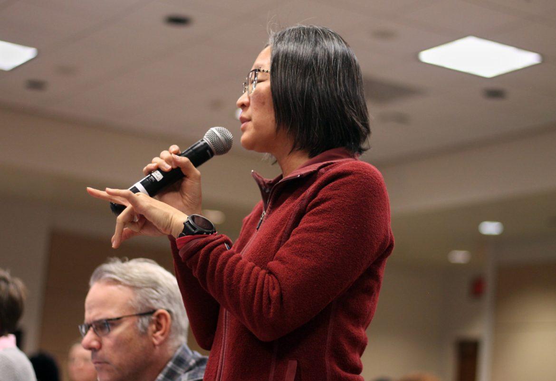 A Female senator giving comments ot the crowd,.