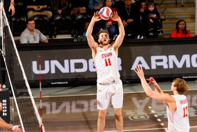 A CSUN Men's volleyball setter passing the ball to his teammate.