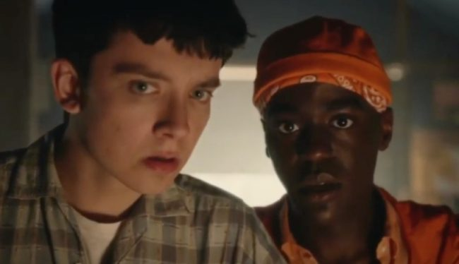 A picture of a white boy and an African American boy