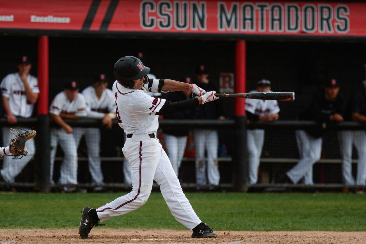 A CSUN Men's Baseball player in white jersey trying to hit the ball