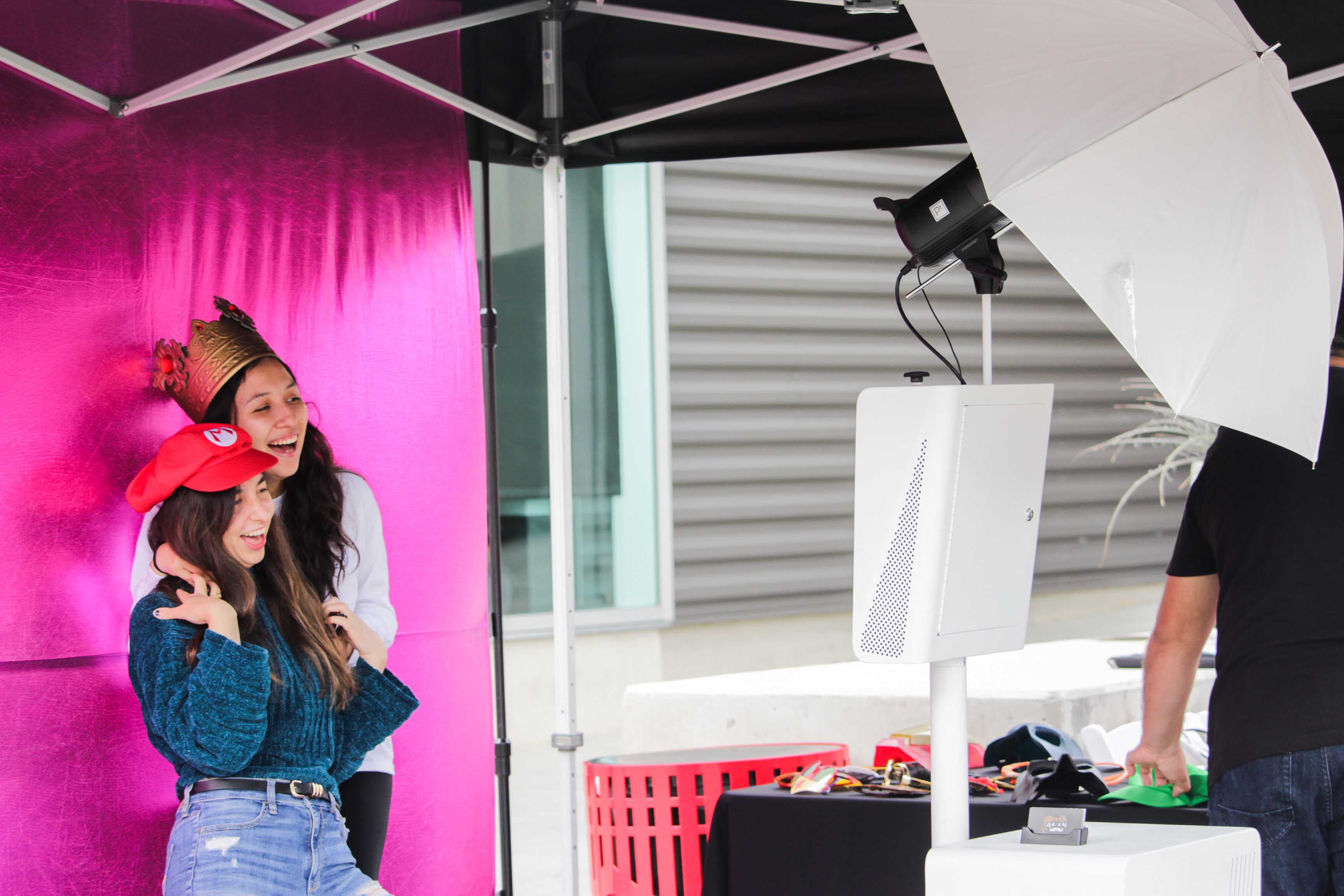 Seniors Marlena Klein and Jocelyn Lazo take pictures at the photo booth during the