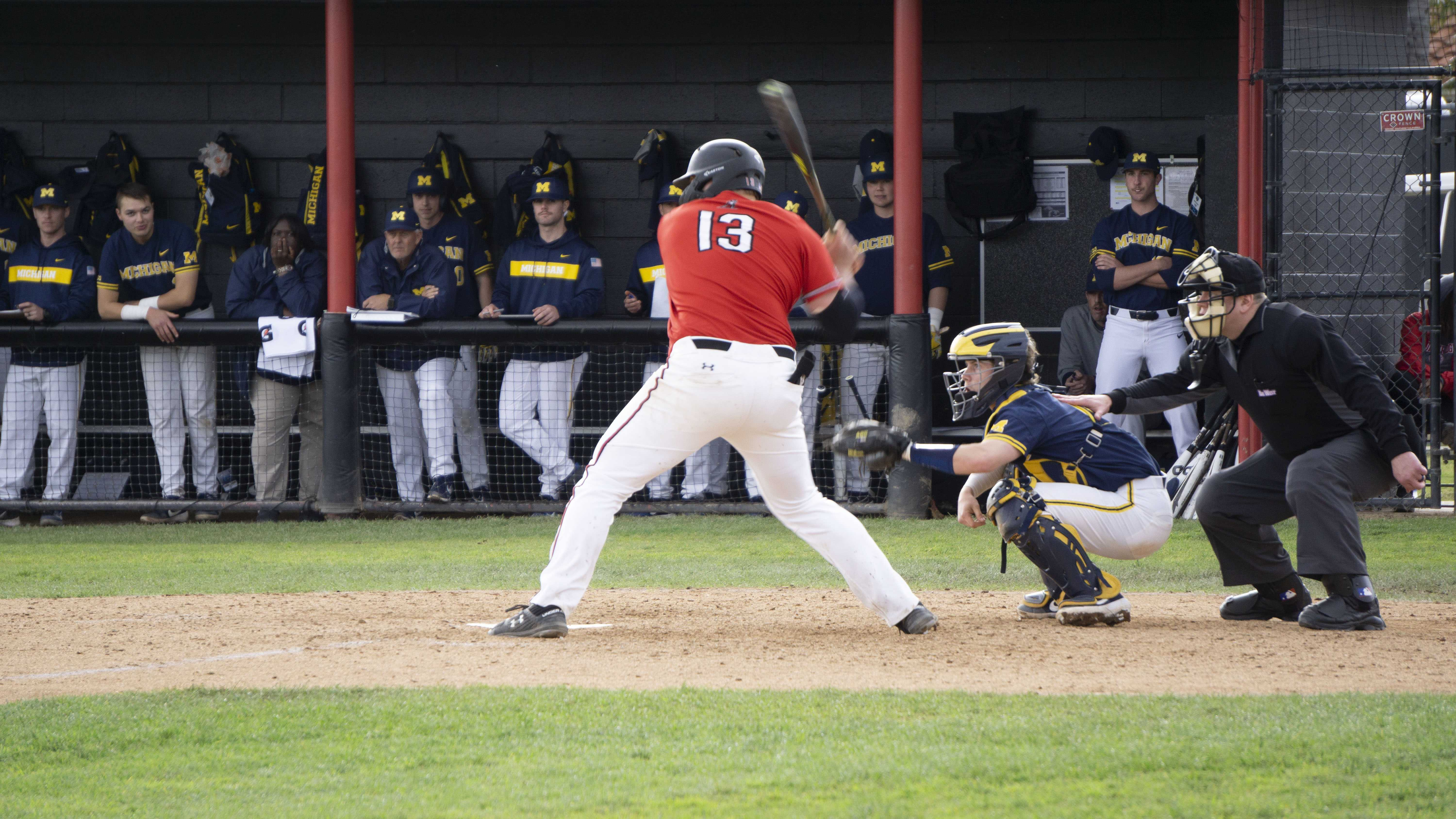 Senior Jayson Newman hits a double to center field in the bottom of the eighth inning Sunday afternoon against No. 17 Michigan. Newman hit .500 in the series with a home run, a double and three RBIs as the Matadors lost two of three to the Wolverines. Photo credit: Jairo Alvarado