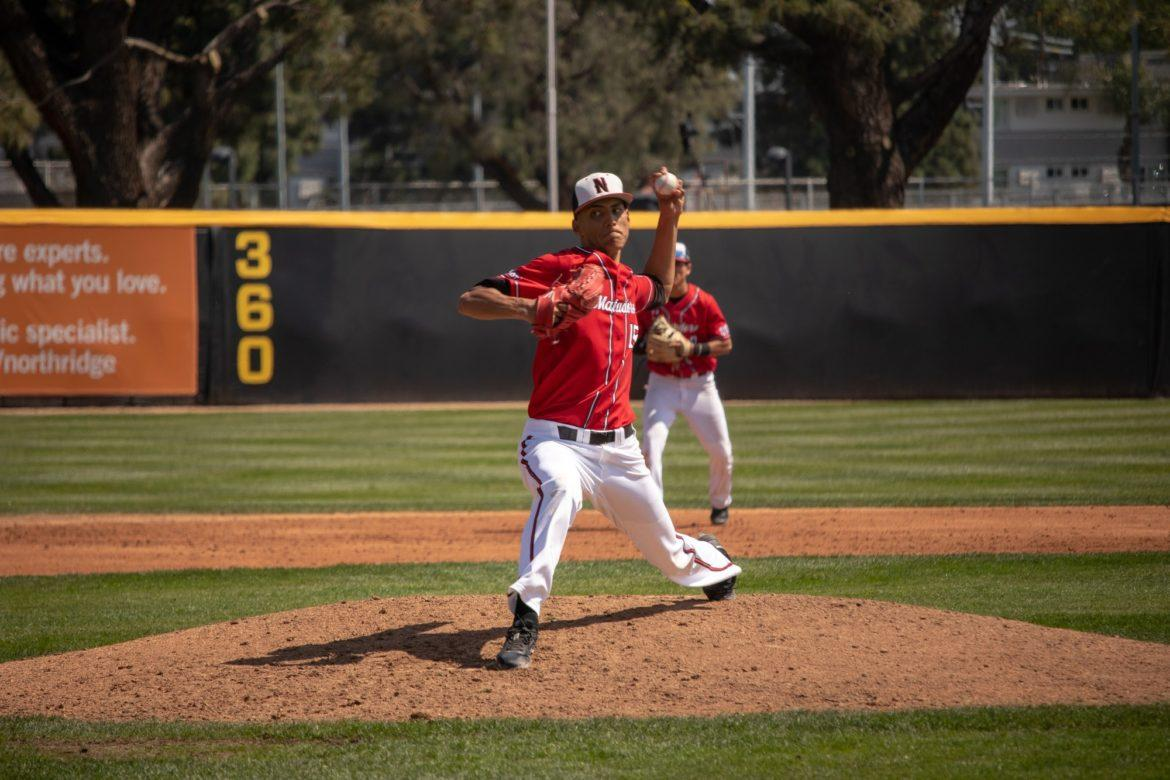 A CSUN Men's Baseball picther in red jersey