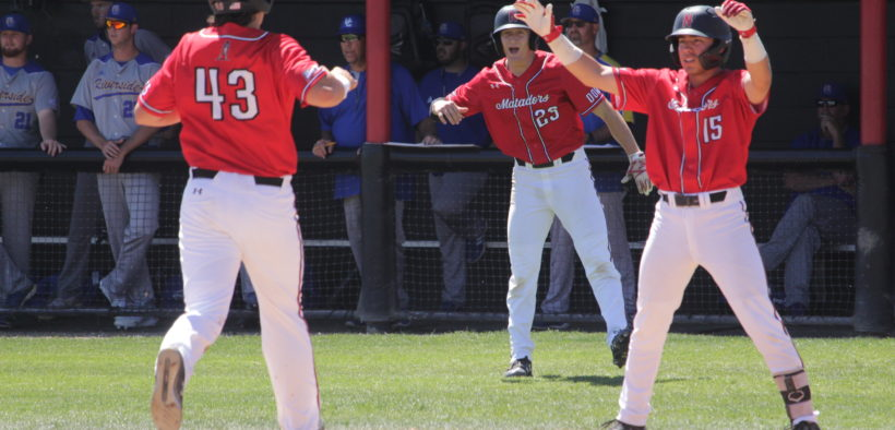 CSUN Baseball scores a point during a game
