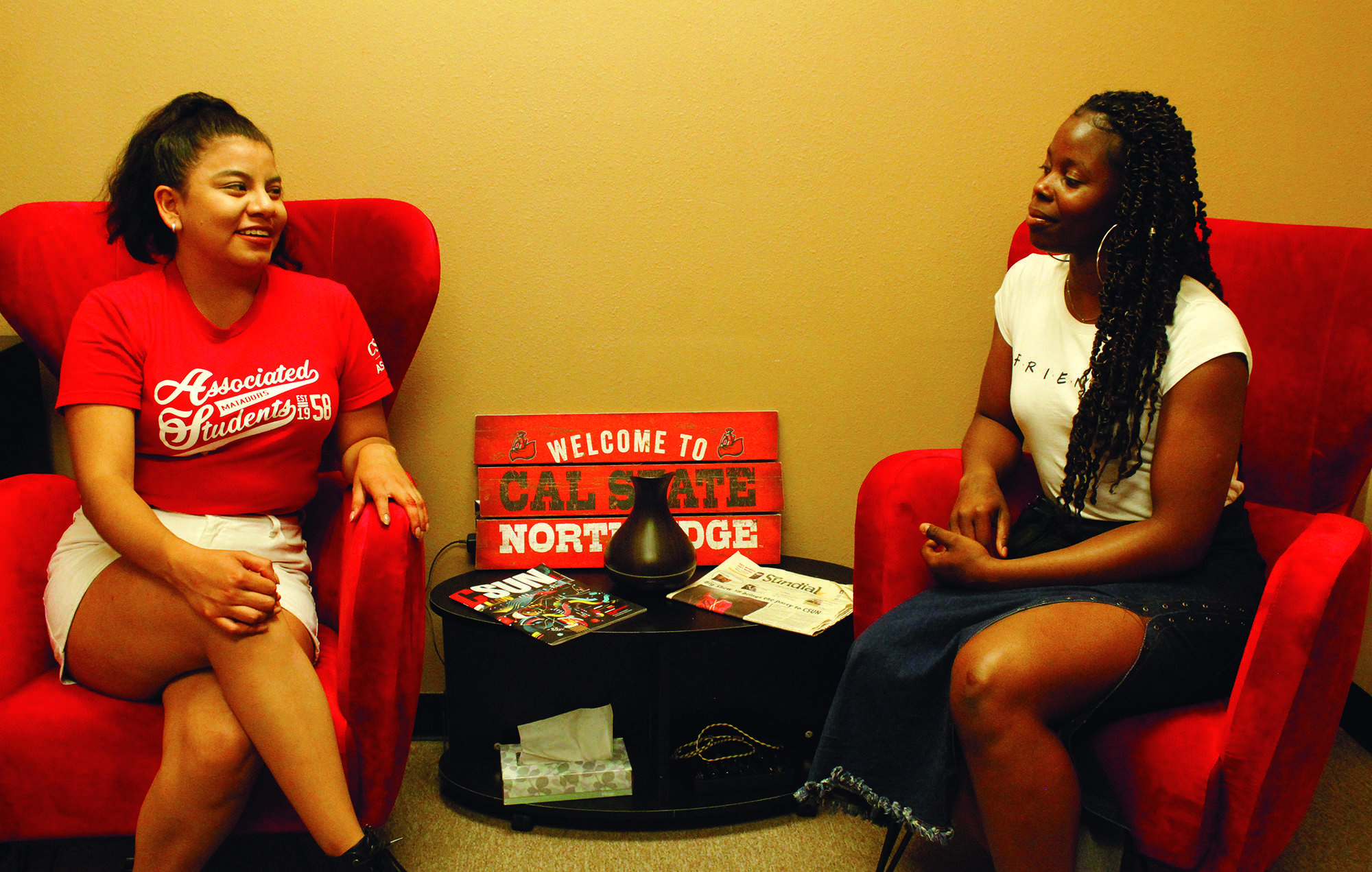 Current AS President Beverly Ntagu (right) gives advice to newly-elected AS President Diana Vicente (left) in the AS offices. Ntagu will graduate in May and Vicente will be sworn into office on June 3. Photo credit: Elijah Carr