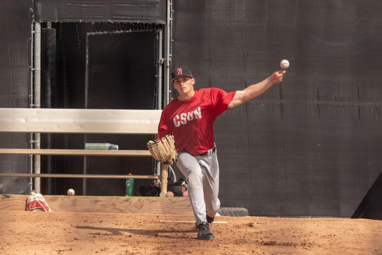 A CSUn Baseball pitcher practices at bullpen