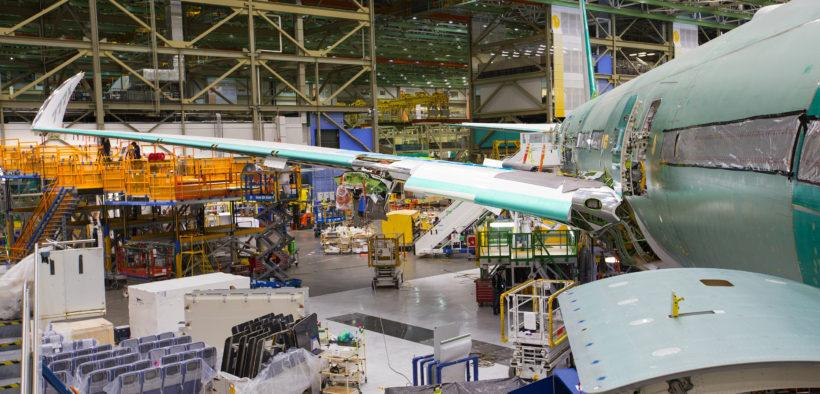 an airplane getting fixed at a factory