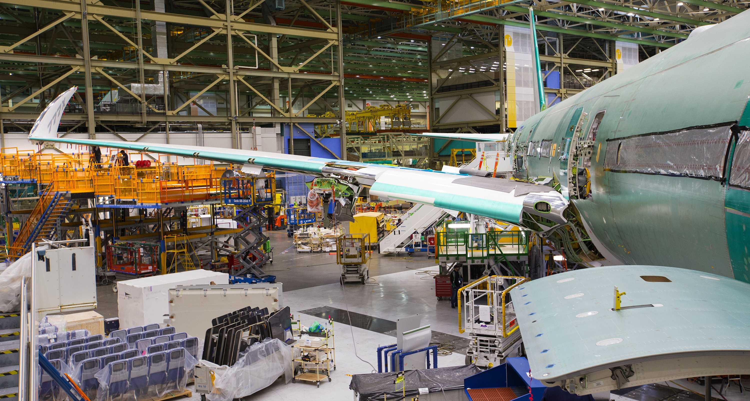 The wing of the new 777X, with the 11-ft wingtip folded up so it can fit inside the Everett assembly bay. It will similiarly be folded up to fit at airport gates. This airplane is the first 777X that will fly in 2019. (Mike Siegel/The Seattle Times/TNS)
