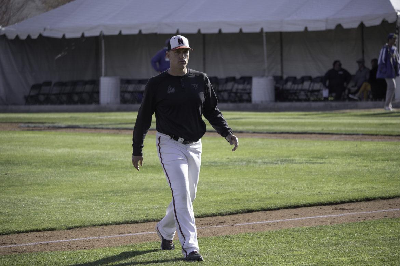 The+CSUN+Baseball+head+coach+walking+on+field