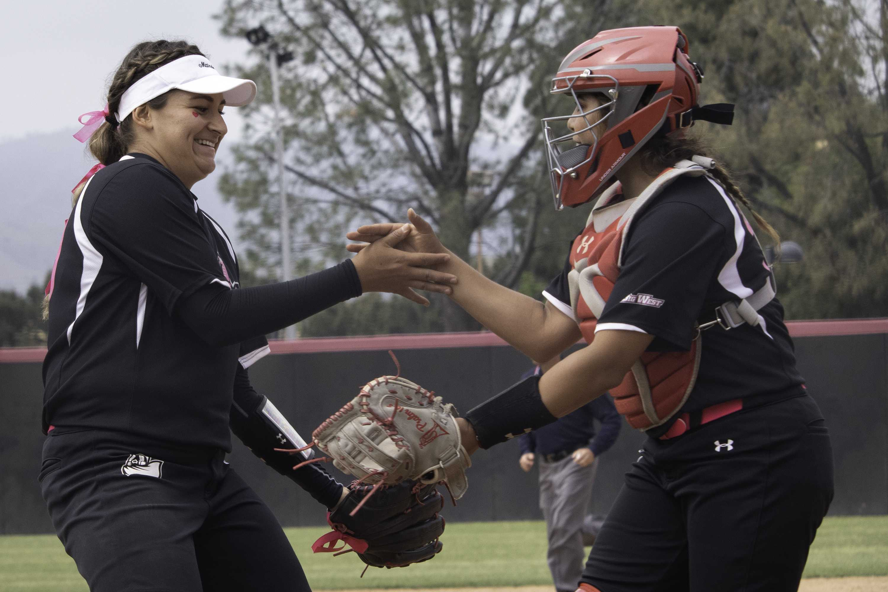 Sophomore Jillian James celebrates with junior Gator Rascon after recording the final out in the win over Cal Poly on Saturday. James pitched 18 total innings in the series, recording complete games in both of the Matadors' wins to earn CSUN's first conference series victory of the season. Photo credit: Tyler Wainfeld