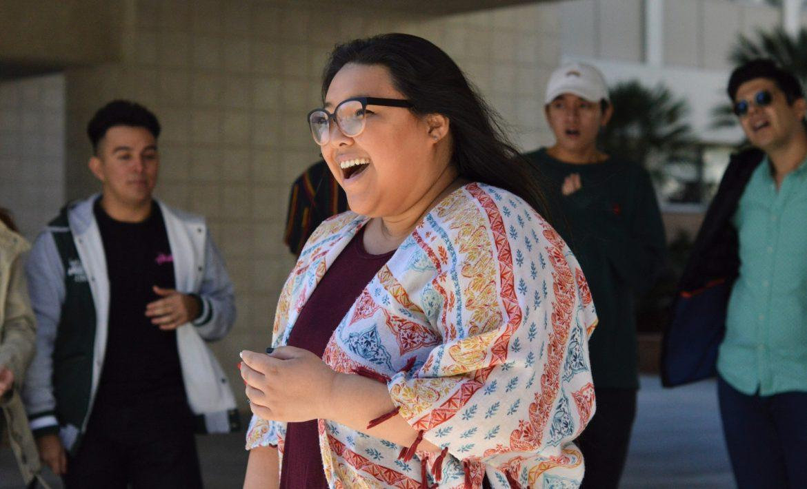 A female CSUn student laughing