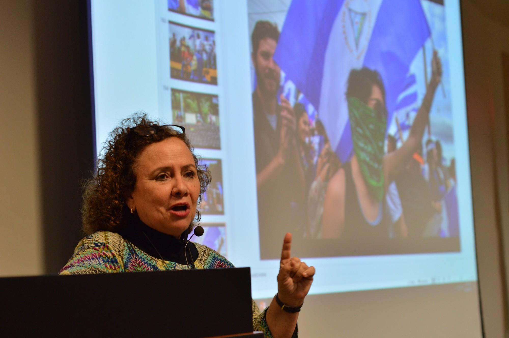 Photojournalist Margarita Montealegre presents her photographs from Nicaragua and other Central American countries at the Oviatt Library on March 29. Many of her photos show important events that happened during both the Nicaraguan and Salvadorian civil wars. Photo credit: Geovanni Botticella