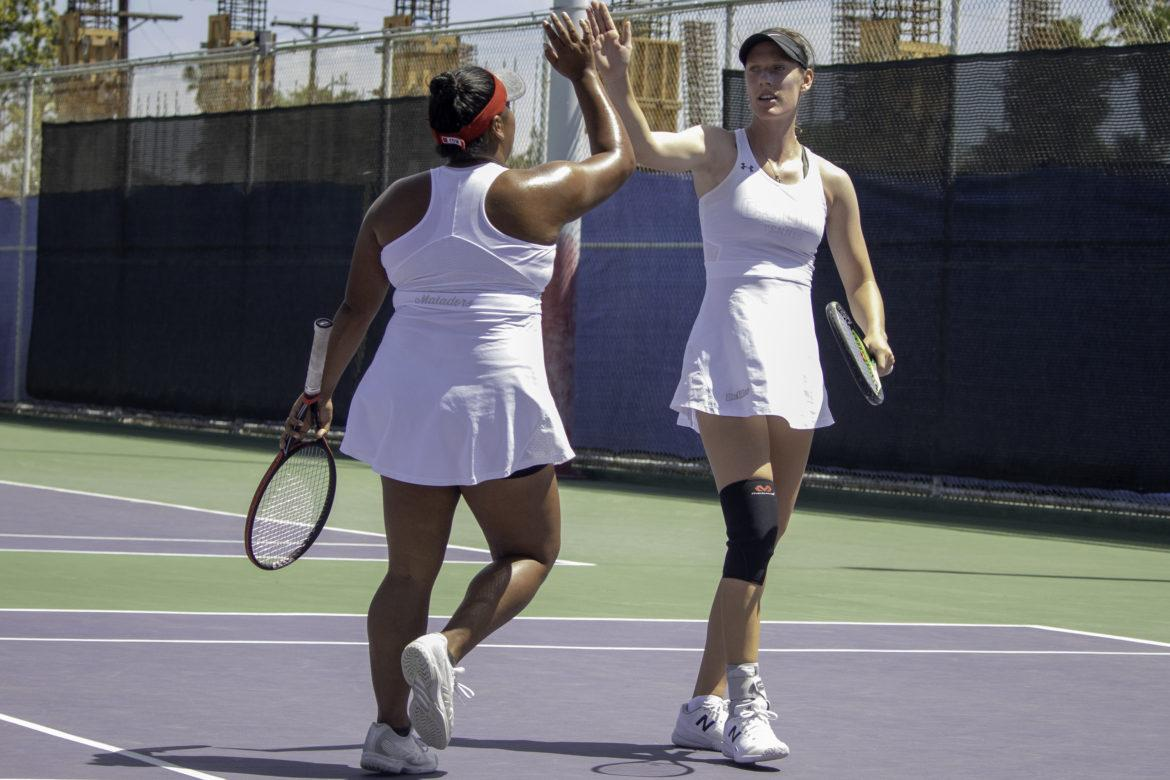 Two+CSUN+Women%27s+tennis+players+giving+high+five+to+each+other