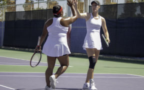 Two CSUN Women's tennis players giving high five to each other