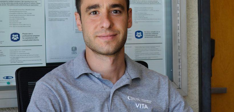 A CSUN Student in VITA polo-shirt