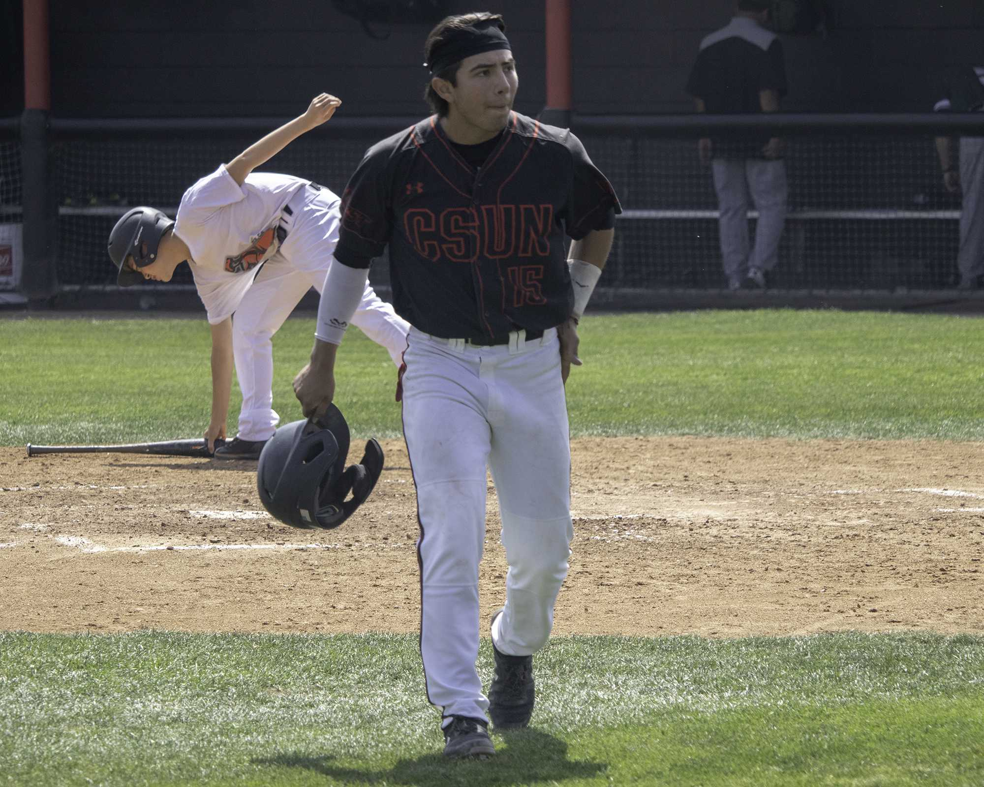 Junior Jose Ruiz Jr. walks back to the dugout during the Matadors' 10-2 victory over Hawaii on Saturday, April 27. Ruiz, who attended CSUN his freshman year in 2016, returned in the fall semester for his junior year and has become a mainstay in head coach Greg Moore's lineup. Photo credit: Tyler Wainfeld