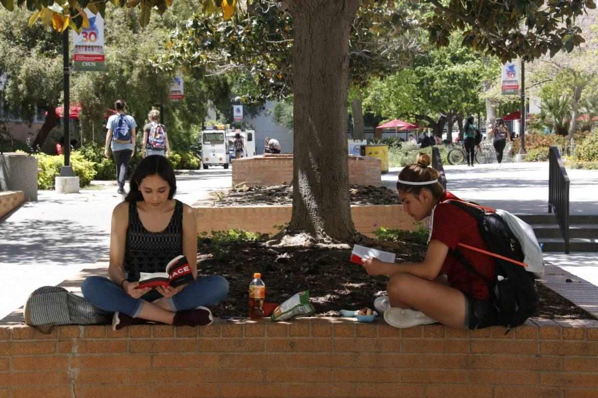 students read under a tree