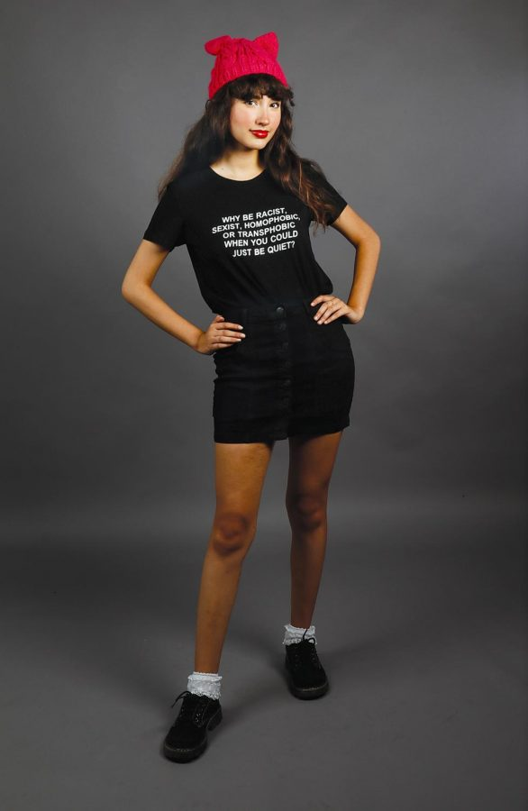 A lady in black t-shirt and skirt