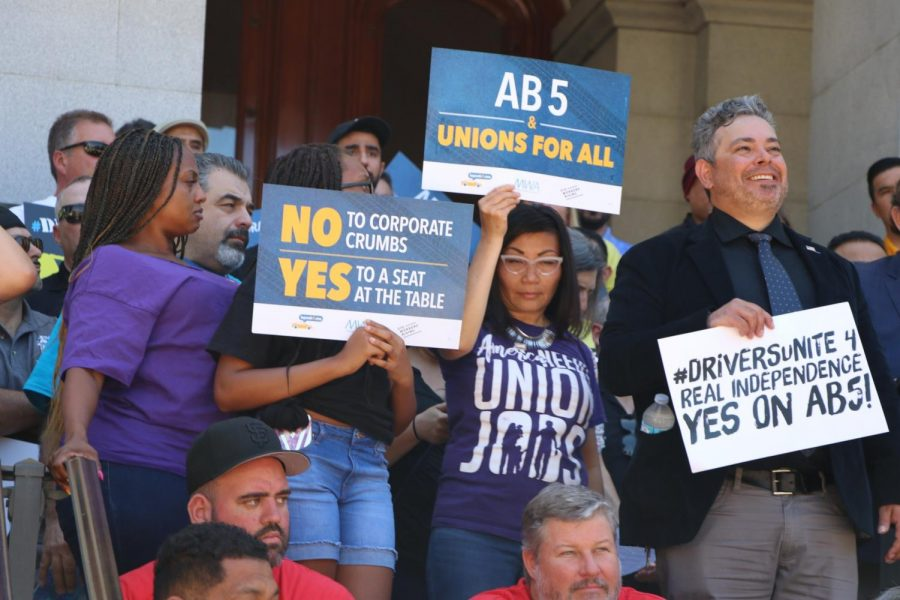 Uber and Lyft drivers protest in support of AB5 in Sacramento on July 10