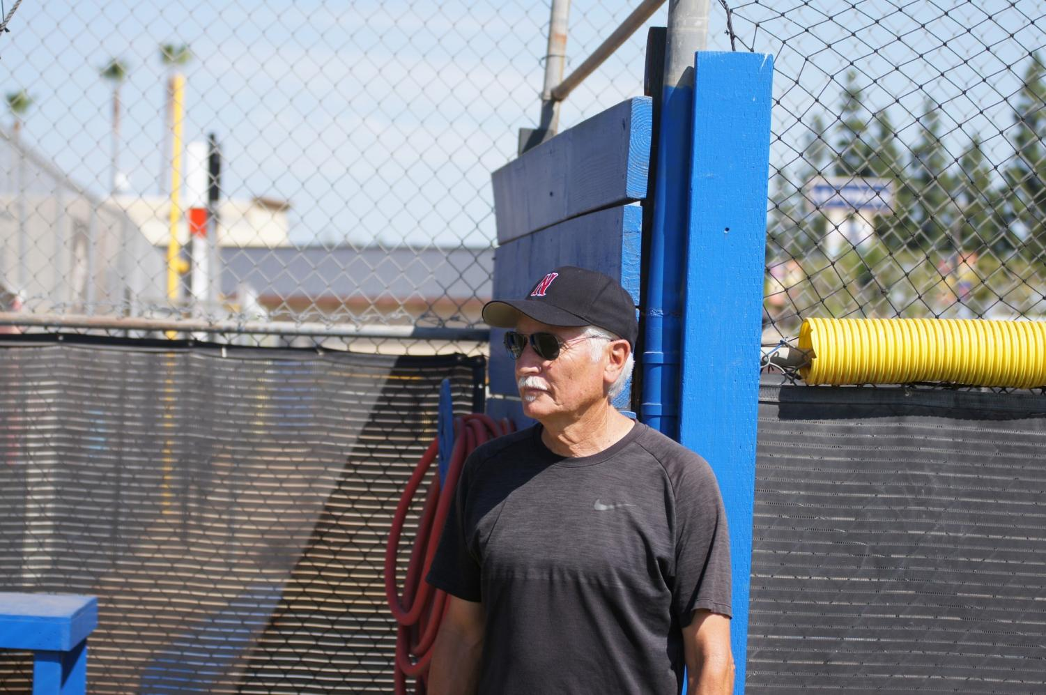 Larry Baca, 74, stands in the same dugout he used to coach little league in 25 years ago. Photo credit: Bryanna Winner