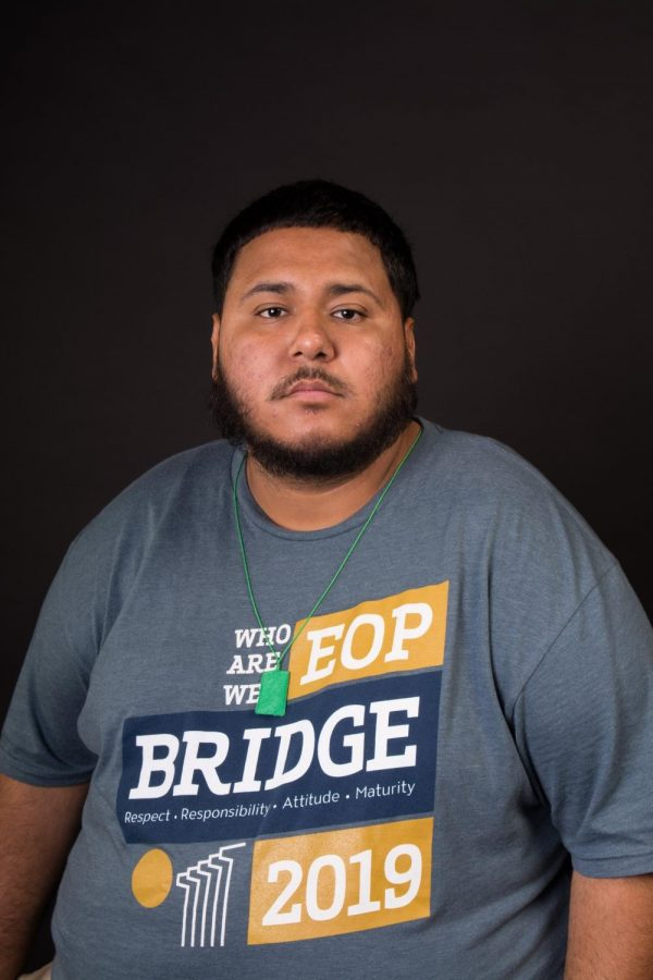 A male student with EOP Program T-shirt
