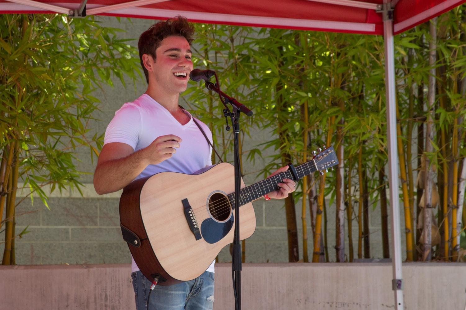 Matt Anspach, 20, performs an acoustic set during the USU Noontime Concert on Sept. 5. Photo credit: Serena Christie