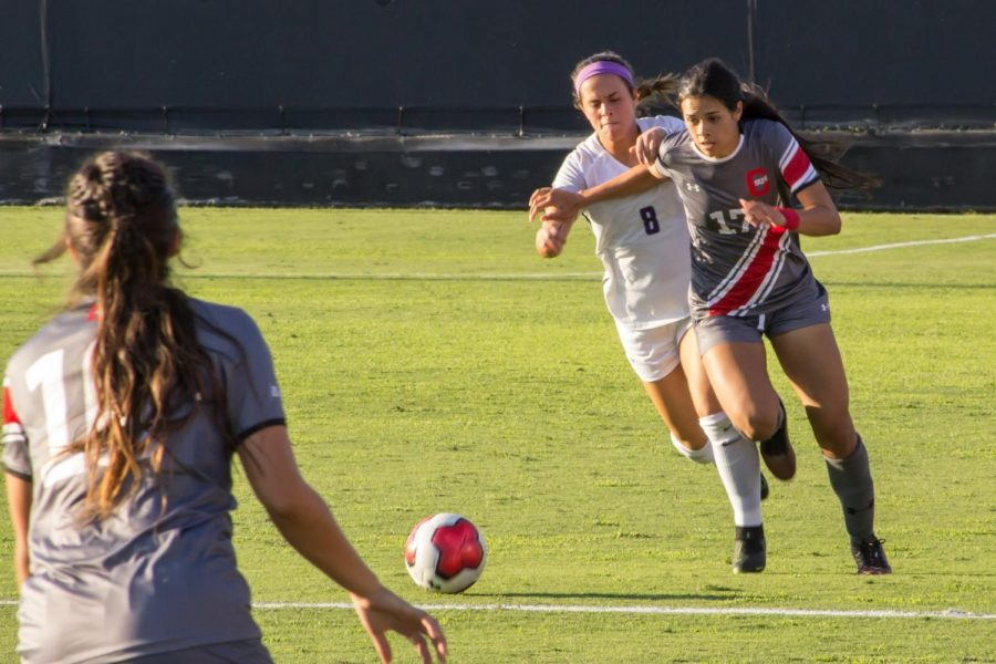 CSUN+Women%27s+Soccer+player+trying+to+get+pass+the+opponent