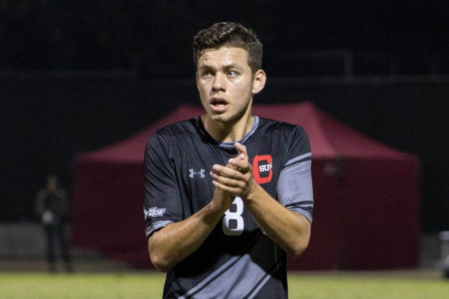 A CSUN Men's Soccer player in black jersey