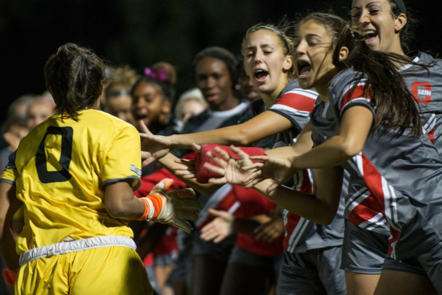 A+CSUN+Women%27s+Soccer+player+giving+high-five+to+her+teammates
