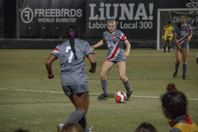 Defender Kacie Garrity dribbles the ball down Matador Soccer Field during a match up against Cal Poly on Oct. 10. Photo credit: Logan Bik