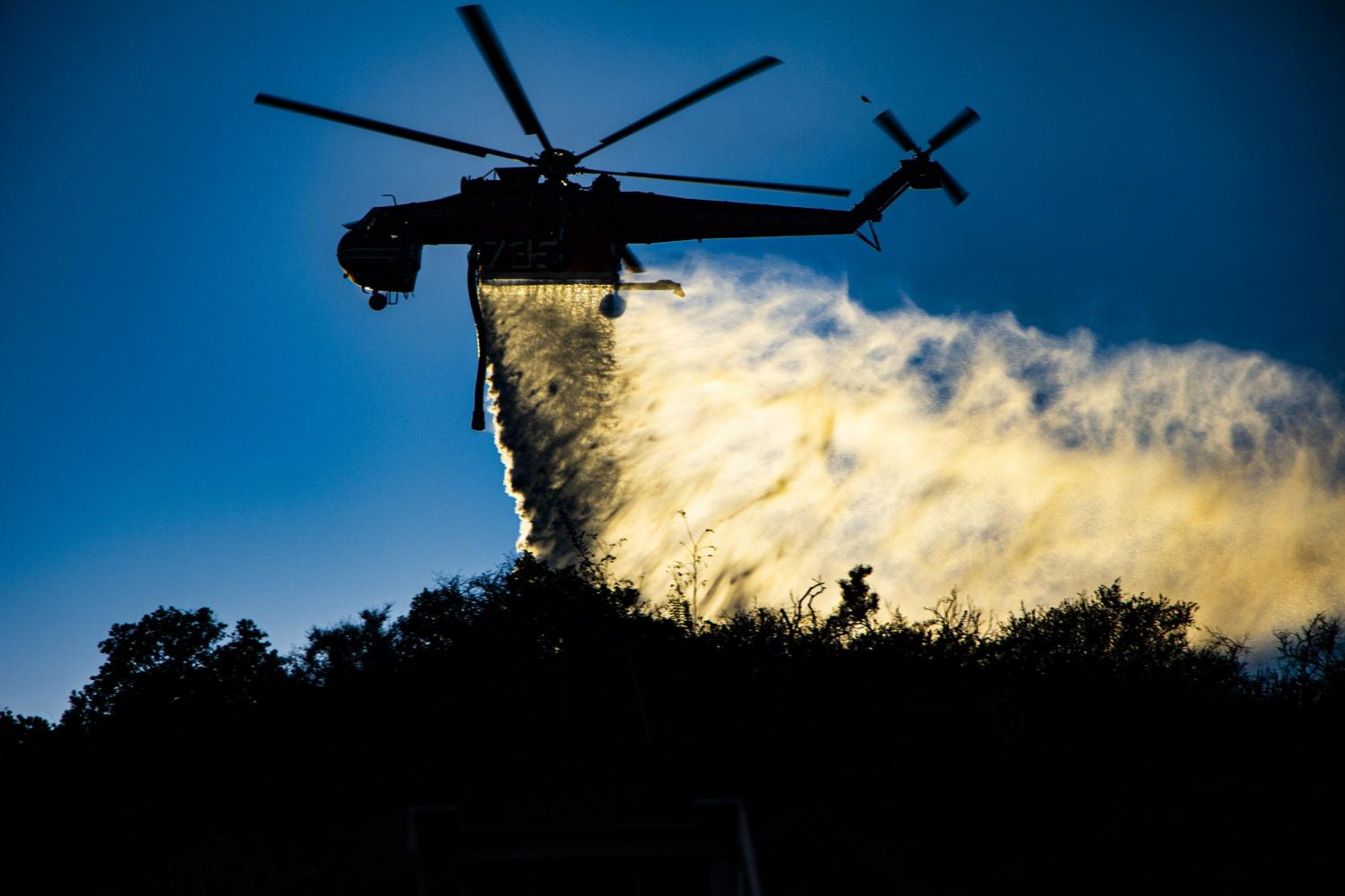 A Cal-Fire Skycrane makes a water drop on the Getty Fire near the I-405 around 5:30 p.m. on Oct. 28. Photo credit: Tim Strong