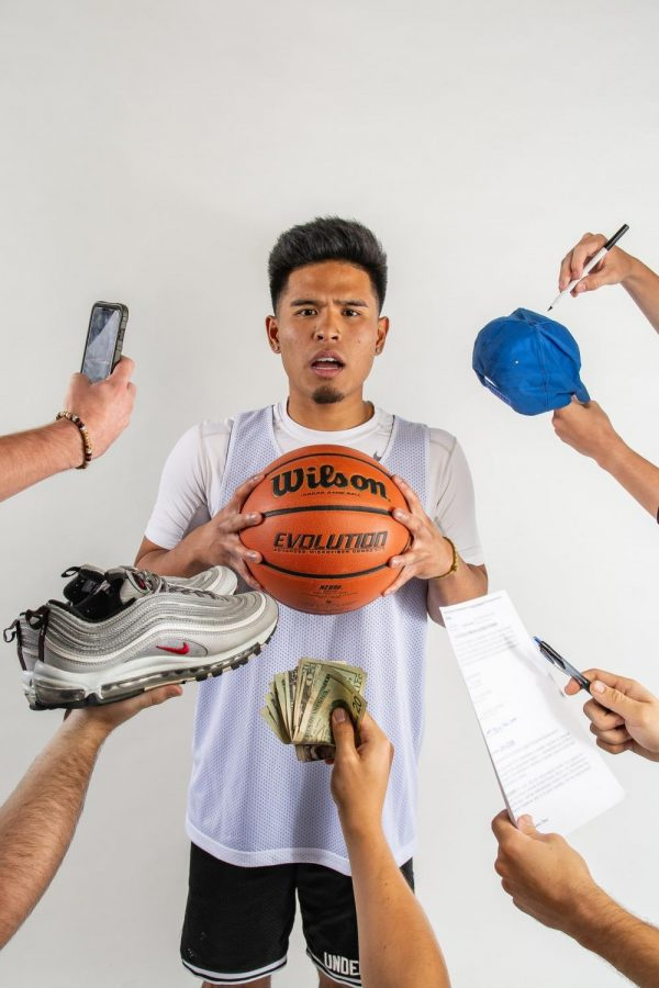 A male student holding a basketball with 5 different surround him