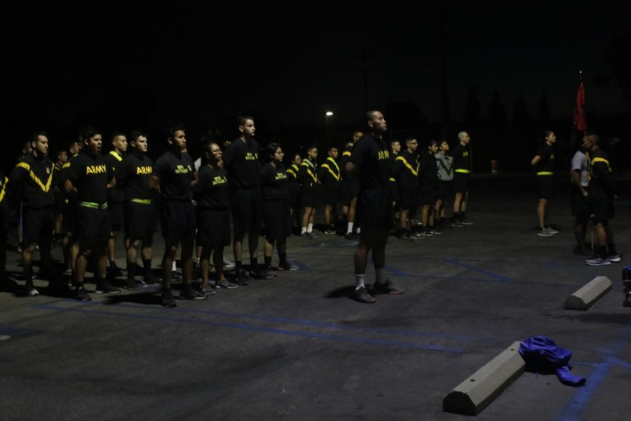 An army group in formation waiting for instruction