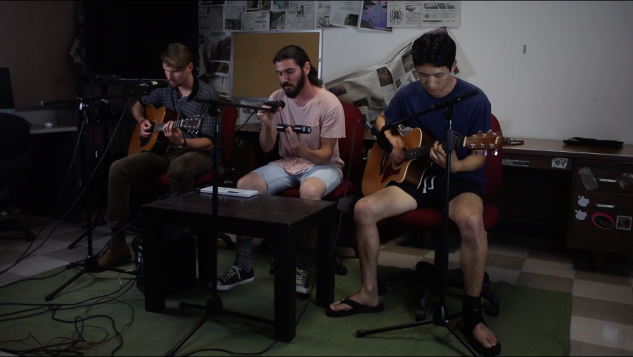 three+guys+playing+different+instruments