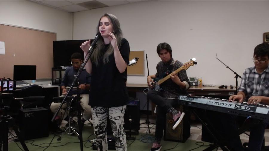 A female singer singing in a studio