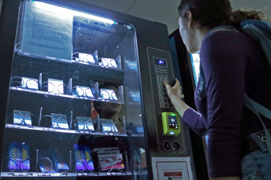 A female student using the vending machine