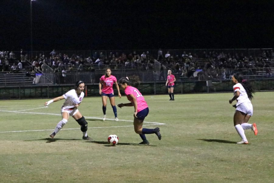 A CSUN Women's Soccer player defending an opponent