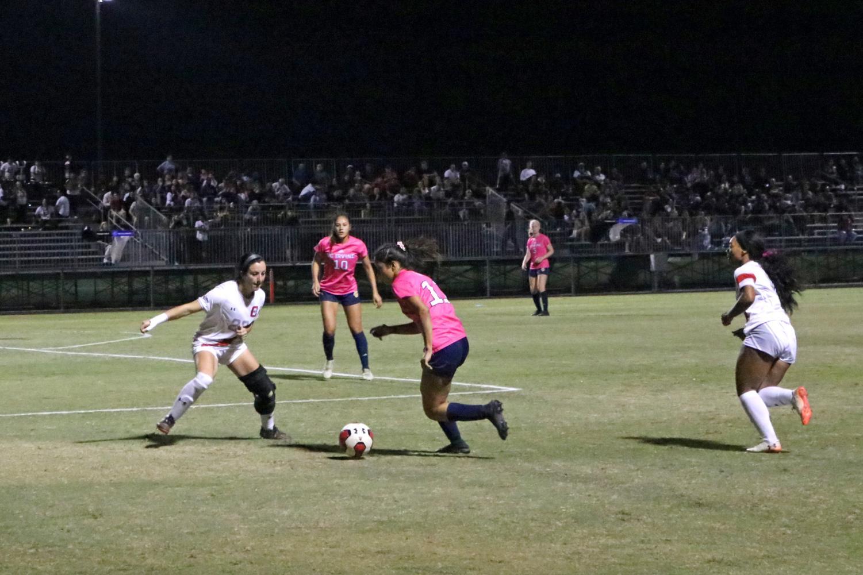 CSUN reshirt senior defender, Amber Edemann, attempts to stop UC Irvine's offense during their game on Oct. 24. Photo credit: Edward Nenedzhyan